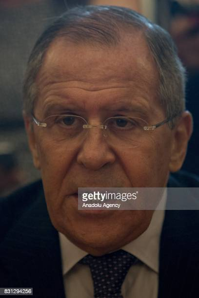 Russian Foreign Minister Sergei Lavrov speaks with Libyan National Army Commander Khalifa Haftar during their meeting in Moscow Russia on August 14...