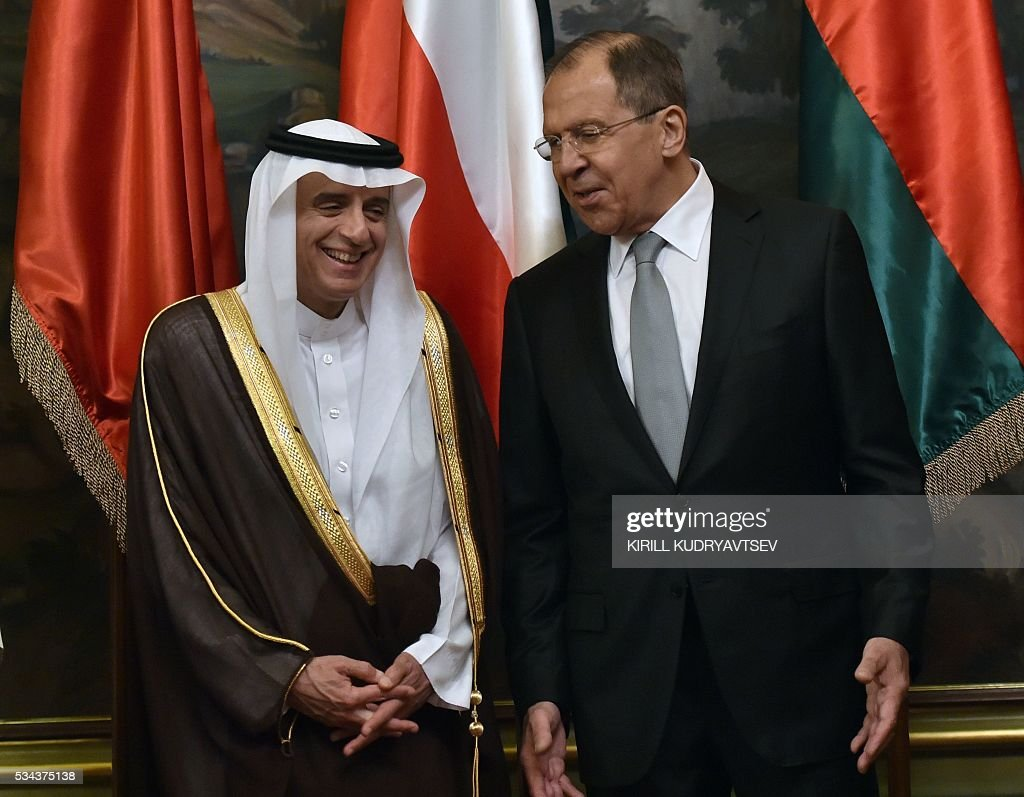 Russian Foreign Minister Sergei Lavrov (R) talks to Saudi Arabia's Foreign Minister Adel al-Jubeir as they pose for a family picture during a meeting in Moscow on May 26, 2016. / AFP / KIRILL