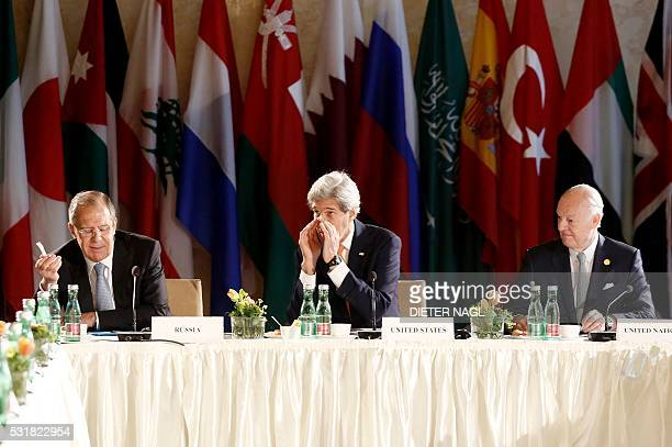 TOPSHOT Russian Foreign Minister Sergei Lavrov US Secretary of State John Kerry and UN Special envoy for Syria Staffan de Mistura attend talks on...