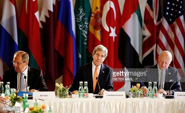 Russian Foreign Minister Sergei Lavrov US Secretary of State John Kerry and UN Special envoy for Syria Staffan de Mistura attend talks on Syria on...