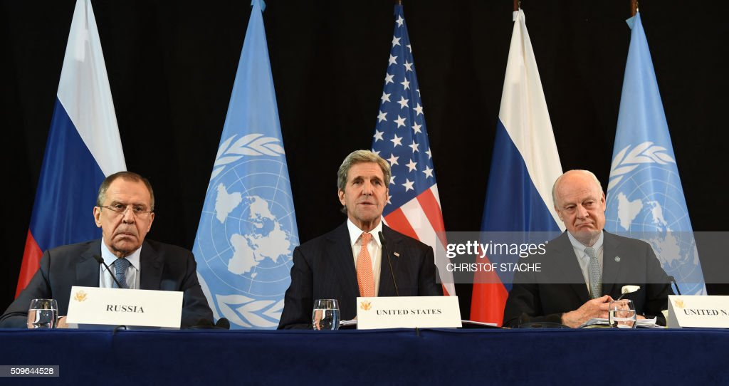 Russian Foreign Minister Sergei Lavrov, US Secretary of States John Kerry and UN Special Envoy for Syria Staffan de Mistura follow a news conference after the International Syria Support Group (ISSG) meeting in Munich, southern Germany, on February 12, 2016. / AFP / Christof STACHE