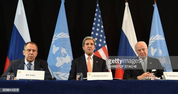 TOPSHOT Russian Foreign Minister Sergei Lavrov US Secretary of States John Kerry and UN Special Envoy for Syria Staffan de Mistura follow a news...