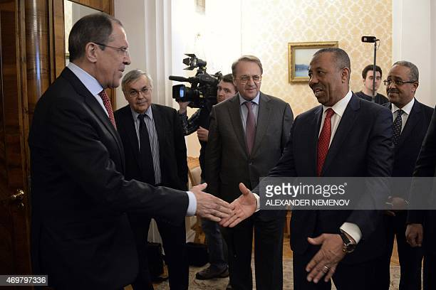 Russian Foreign Minister Sergei Lavrov welcomes Libyan Prime Minister Abdullah alThani during their meeting in Moscow on April 15 2015 AFP PHOTO /...