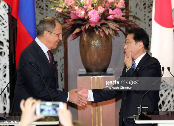 Russian Foreign Minister Sergei Lavrovand Japanese Foreign Minister Fumio Kishida shake hands after a joint press conference after their meeting at...