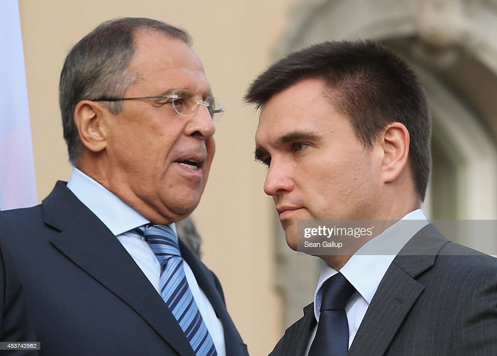 Russian Foreign Minister Sergey Lavrov (L) and Ukrainian Foreign Minister <a gi-track='captionPersonalityLinkClicked' href=/galleries/search?phrase=Pavlo+Klimkin&family=editorial&specificpeople=12902005 ng-click='$event.stopPropagation()'>Pavlo Klimkin</a> pass by one another while arriving for a group photo with French Foreign Minister Laurent Fabius and German Foreign Minister Frank-Walter Steinmeier (both not pictured) during talks over the ongoing conflict in eastern Ukraine at Villa Borsig on August 17, 2014 in Berlin, Germany. The four men are meeting as at least one confirmed incursion by military vehicles from Russian soil into Ukraine and the statement by a separatist leader that Russia had supplied separatists fighting in Ukraine with heavy tanks, training and personnel have heightened tension as well as the fears of a possible imminent Russian invasion.