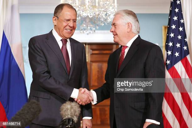 Russian Foreign Minister Sergey Lavrov and US Secretary of State Rex Tillerson shake hands in the Treaty Room before heading into meetings at the...