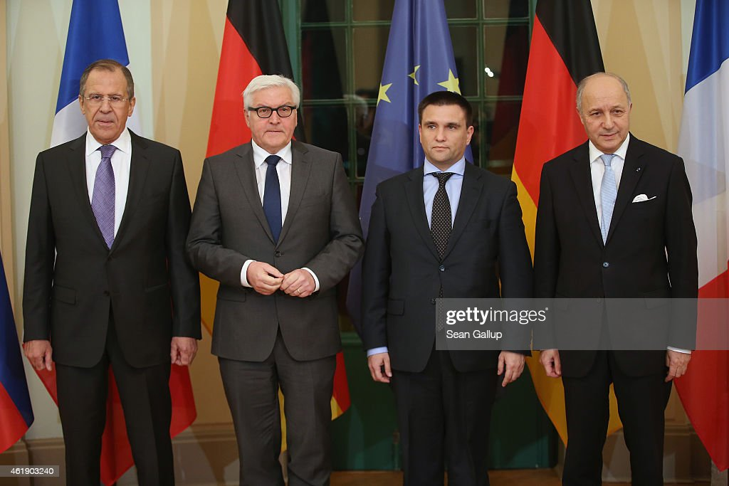Russian Foreign Minister Sergey Lavrov, German Foreign Minister Frank-Walter Steinmeier, Ukrainian Foreign Minister Pavlo Klimkin and French Foreign Minister Laurent Fabius pose for the media prior to meeting to discuss the ongoing conflict in eastern Ukraine at Villa Borsig on January 21, 2015 in Berlin, Germany. The four men are meeting as fighting between the Ukrainian Army and Russian-backed separatists in the Donbas region of eastern Ukraine has increased in the last few weeks.