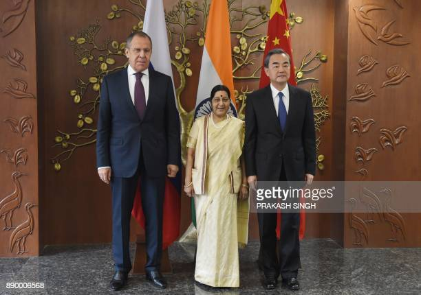 Russian Foreign Minister Sergey Lavrov Indian External Affairs Minister Sushma Swaraj and Chinese Foreign Minister Wang Yi pose for a photograph...