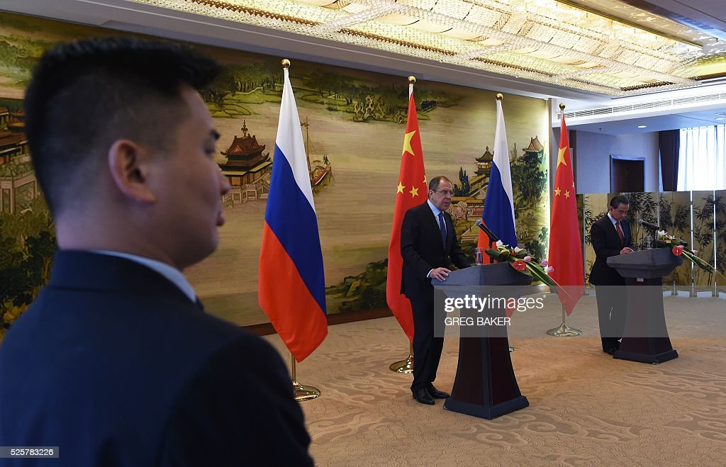 Russian Foreign Minister Sergey Lavrov (C) speaks during a joint press conference with Chinese Foreign Minister Wang Yi (R) at the Ministry of Foreign Affairs in Beijing on April 29, 2016. / AFP / GREG
