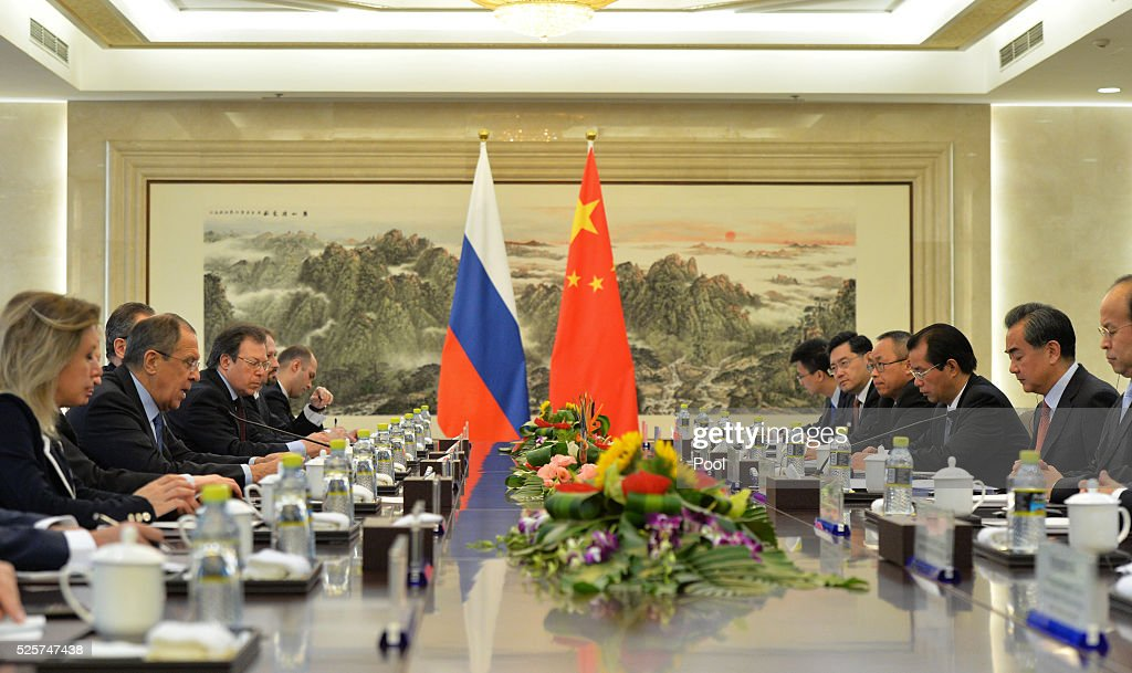 Russian Foreign Minister Sergey Lavrov (2L) speaks with Chinese Foreign Minister <a gi-track='captionPersonalityLinkClicked' href=/galleries/search?phrase=Wang+Yi+-+Politicus&family=editorial&specificpeople=13620429 ng-click='$event.stopPropagation()'>Wang Yi</a> (2R) during a meeting at the Ministry of Foreign Affairs on April, 29 2016 in Beijing, China.
