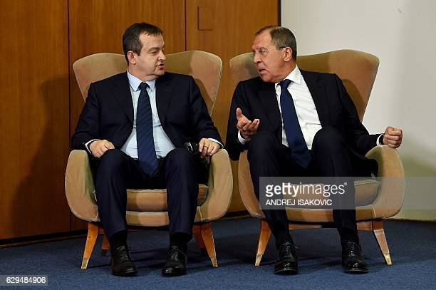 Russian Foreign Minister Sergey Lavrov talks to his Serbian counterpart Ivica Dacic as they sit in armchairs during a press conference after the BSEC...