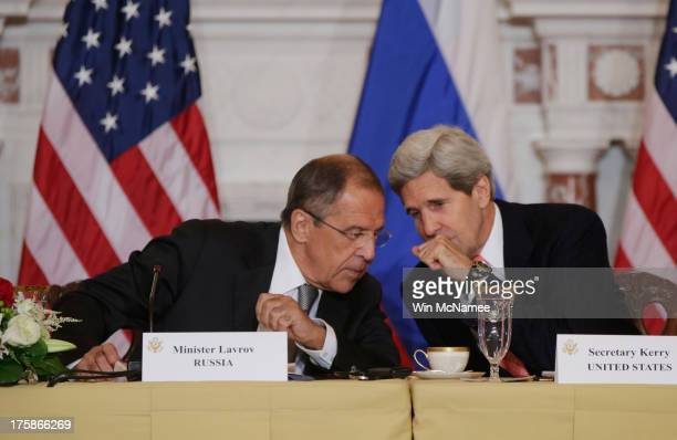 Russian Foreign Minister Sergey V Lavrov and US Secretary of State John Kerry talk during a meeting at the US State Department on August 9 2013 in...