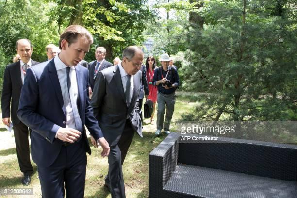 Russian Foreign Minister Sergey Viktorovich Lavrov walks with Austria Foreign Minister Sebastian Kurz during the OSCEmeeting 'Building Trust through...