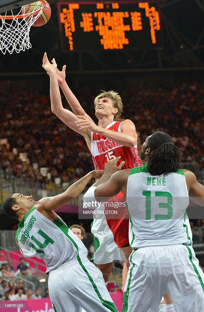 Russian forward Andrey Kirilenko (C) Brazilian centre Nene Hilario (R) and Brazilian guard Marquinhos Vieira Sousa during the men's preliminary round basketball match Brazil vs Russia of the London 2012 Olympic Games on August 2, 2012 at the basketball arena in London. Russia won 75-74.