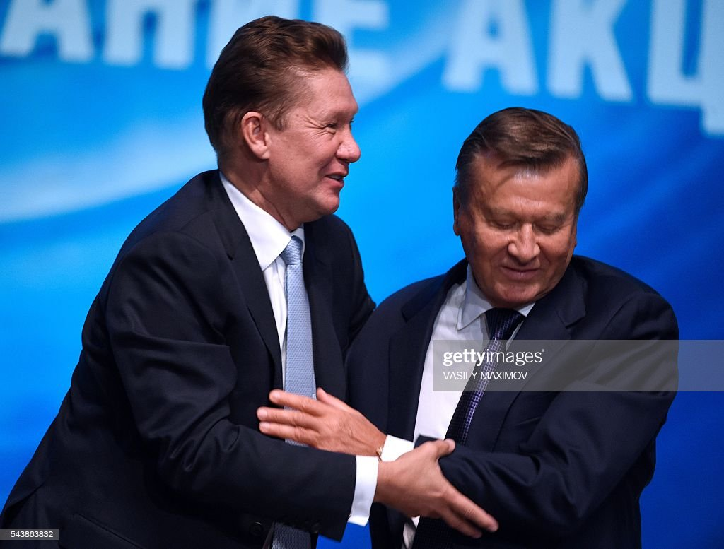 Russian gas giant Gazprom's Chief Executive Officer (CEO) Alexei Miller (L) hugs the Chairman of the Board of Directors of Gazprom Viktor Zubkov during a press conference after the annual meeting of the company's shareholders in Moscow on June 30, 2016. / AFP / VASILY