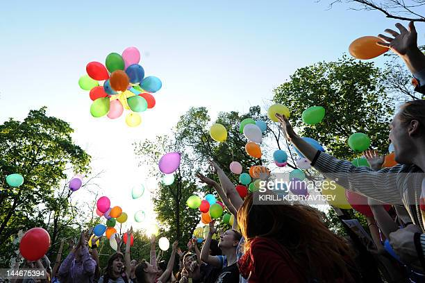 Russian gay rights activists launch balloons during an event dubbed Against Homophobia Day in central Moscow on May 17 2012 AFP PHOTO/KIRILL...