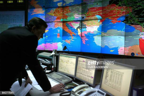 A Russian Gazprom employee works at the central control room of the Gazprom headquarters in Moscow on January 14 2009 The ministers were in Russia to...