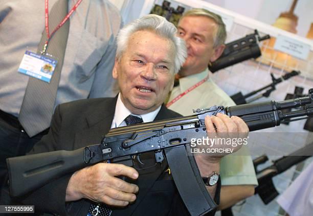 Russian General Mikhail Kalashnikov the inventor of the AK47 assault rifle that bears his name holds up an AK102 Kalashnikov 16 October 2002 at Marka...