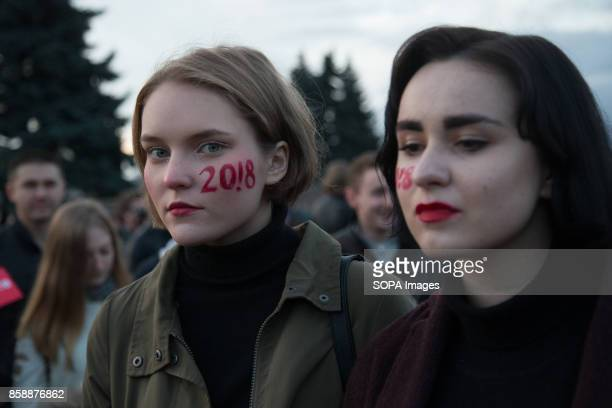 Russian girls with '2018' mark in their cheeks are seen participating in an unauthorized rally The President of Russia Vladimir Putin celebrated his...