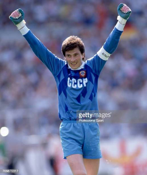 Russian goalkeeper and captain Rinat Dasayev raises both arms in the air during play for the Soviet Union team in the UEFA Euro 1988 European...