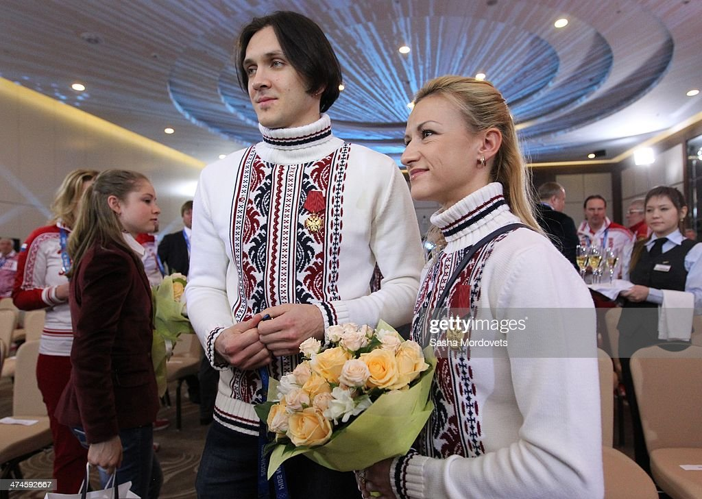 Russian Gold Olympic medalists in figure skating <a gi-track='captionPersonalityLinkClicked' href=/galleries/search?phrase=Maxim+Trankov&family=editorial&specificpeople=798054 ng-click='$event.stopPropagation()'>Maxim Trankov</a> (C) and Tatyana Volosozhar (R) speak to the media seen during an awards ceremony for Russian Olympic athletes on February 24, 2014 in Sochi, Russia. Russian President Vladimir Putin presented awards to members of the Russian Olympic team a day after the closing ceremony of the 2014 Winter Olympics, in which Russia topped the medals table with 13 gold, 11 silver and 9 bronze medals.