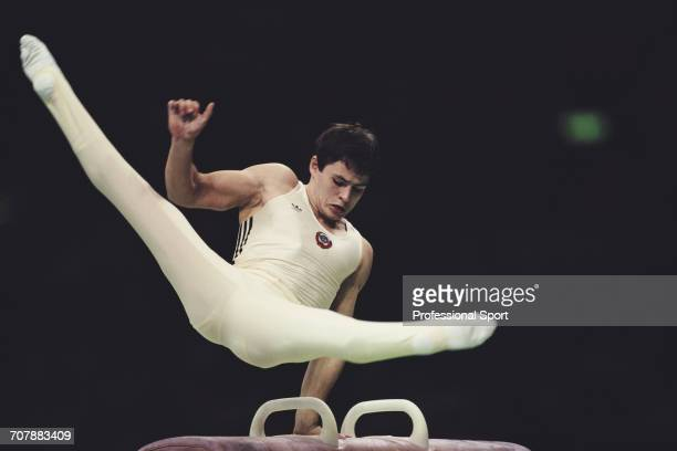 Russian gymnast Dmitry Bilozerchev competing for the Soviet Union pictured in action on the pommel horse during competition to win the bronze medal...