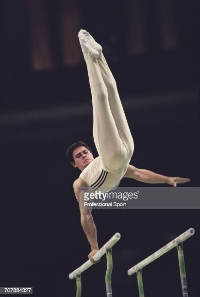 Russian gymnast Dmitry Bilozerchev competing for the Soviet Union pictured in action on the parallel bars during competition to win the bronze medal...