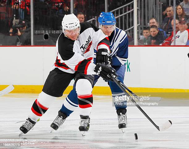Russian Hockey Legend Alexey Yashin and North American Hockey Legend Claude Lemieux battle for a loose puck during the Global Hockey Legends For...