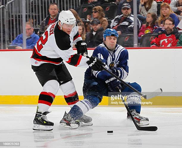 Russian Hockey Legend Evgeny Shtepa and North American Hockey Legend Claude Lemieux battle for a loose puck during the Global Hockey Legends For...