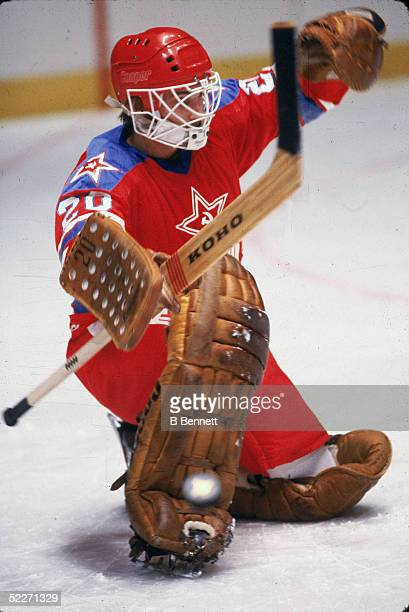 Russian hockey Vladislav Tretiak in the uniform of the Central Red Army deflects the puck with his stick during a game at Madison Square Gaarden New...
