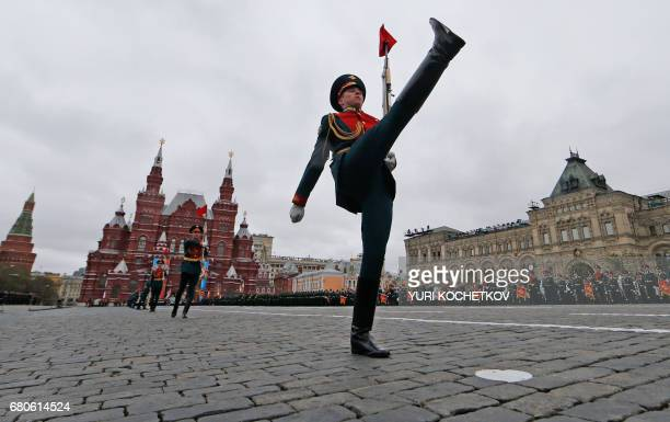 TOPSHOT Russian honour guard soldiers march at Red Square during the Victory Day military parade in Moscow on May 9 2017 Russia marks the 72nd...