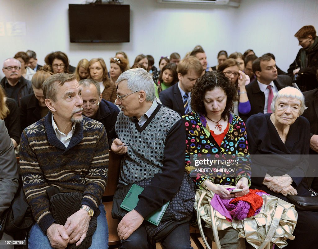 Russian human rights advocate Lev Ponomarev (L) and Moscow Helsinki Group president Lyudmila Alexeyeva (R) sit in a courtroom in Moscow, on April 25, 2013, as they attend the hearing of the NGO Golos (Voice) case. A Russian court heard today a case against election monitoring NGO Golos over its alleged failure to declare its status as a 'foreign agent', the first such process since controversial legislation was passed last year.