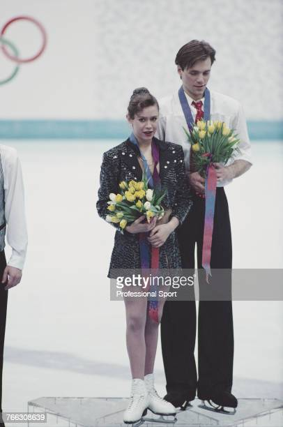 Russian ice dancers Oksana Grishuk and Evgeni Platov of the Russia team pictured together on the medal podium after finishing in first place to win...