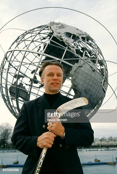 Russian ice hockey coach Viacheslav Fetisov of the New Jersey Devils poses with a hockey stick in front of the Unisphere on the grounds of the 1964...