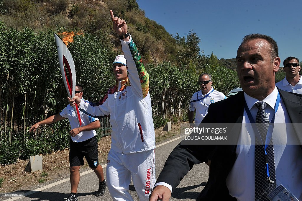 Russian ice hockey player, Alexander Ovechkin, runs with the Olympic flame in ancient Olympia during the lighting ceremony in ancient Olympia the sanctuary where the Olympic Games were born in 776 B.C. The Olympic flame was lit in Ancient Olympia in Greece, in a solemn ceremony filled with mystery and tradition that signals the final countdown to the start of this year's winter Games in Sochi, Russia.