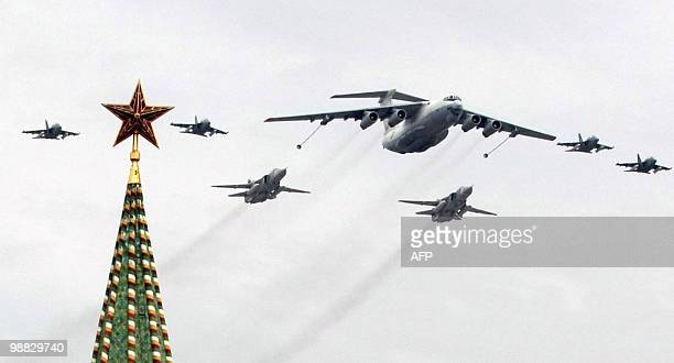 A Russian Il78 inflight refuelling plane and fighter jets fly over the Kremlin near Red Square in Moscow on May 4 2010 during a Victory Day parade...