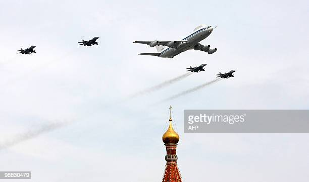 A Russian Il80 plane and fighter jets St Basil's Cathedral near Red Square in Moscow on May 4 2010 during a Victory Day parade rehearsal Russia will...