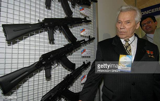 Russian inventor Mikhail Timofeevich Kalashnikov poses with AK series of assault rifles at the International Defence Exhibition ''Defexpo India2004''...
