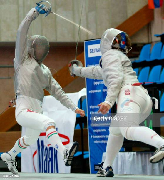 Russian Irina Bazhenova fights with Hungarian Edina Csaba during the final team match of the Euro Fencing Championship in Moscow 06 July 2002...