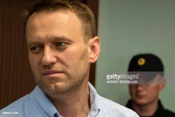 Russian jailed opposition leader Alexei Navalny arrives for a hearing at a court in Moscow on June 16 2017 Navalny has been sentenced to 30 days...