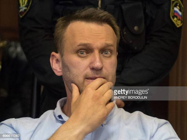 Russian jailed opposition leader Alexei Navalny attends a court hearing in Moscow on June 16 2017 Navalny has been sentenced to 30 days behind bars...