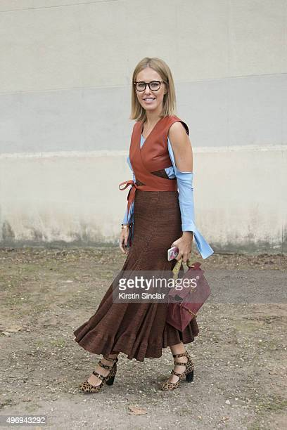 Russian Journalist for L'Officiel Ksenia Sobchak wears a Celine dress Tabitha Simmons shoes and a Hermes bag on day 6 during Paris Fashion Week...