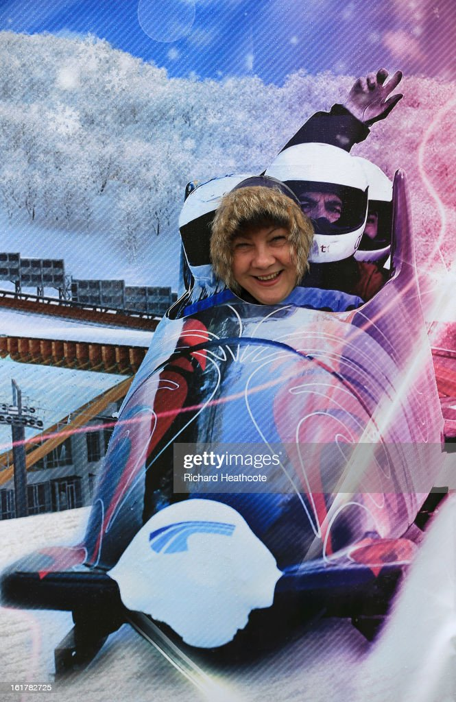 Russian ladies have thier pictures taken through a cutout in the spectator zone during the Viessman FIBT Bob & Skeleton World Cup at the Sanki Sliding Center in Krasnya Polyana on February 16, 2013 in Sochi, Russia. Sochi is preparing for the 2014 Winter Olympics with test events across the venues.