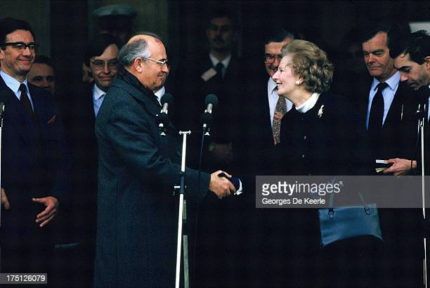 Russian leader Mikhail Gorbachev and former British Prime Minister Margaret Thatcher shake hands at the end of a meeting with former US President...