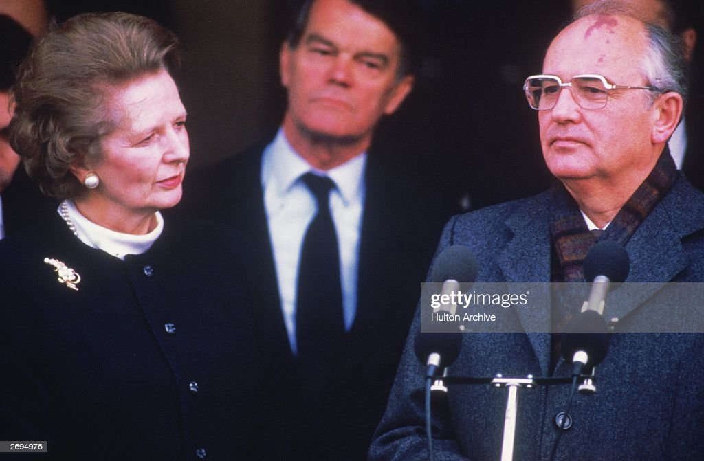 Russian leader Mikhail Gorbachev holds talks with British prime minister Margaret Thatcher at RAF Brize Norton in Oxfordshire. Conservative politician Alan Clark is visible between them.