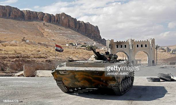A Russian made Syrian army armoured personnel carrier roles along a street leading into Syria's ancient Christian town of Maalula scene of fighting...