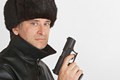 A gun toting, scarred Eastern European gangster