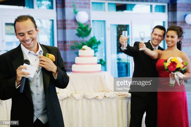 Russian man giving toast at wedding