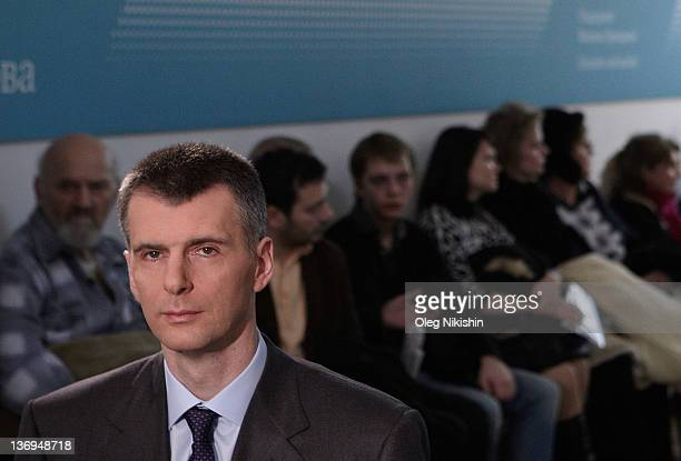 Russian metals tycoon and New Jersey Nets owner Mikhail Prokhorov meets with his supporters at one his campaign offices on January 13 2012 in Moscow...