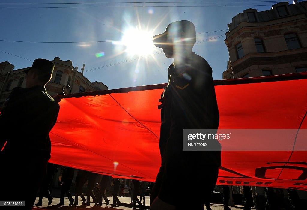Russian military cadets carry a giant replica of the Soviet Banner of Victory during the Immortal Regiment march devoted to the celebrations marking the 70th anniversary of the Allied victory over Nazi Germany in World War II in central Saint Petersburg on May 5, 2016.